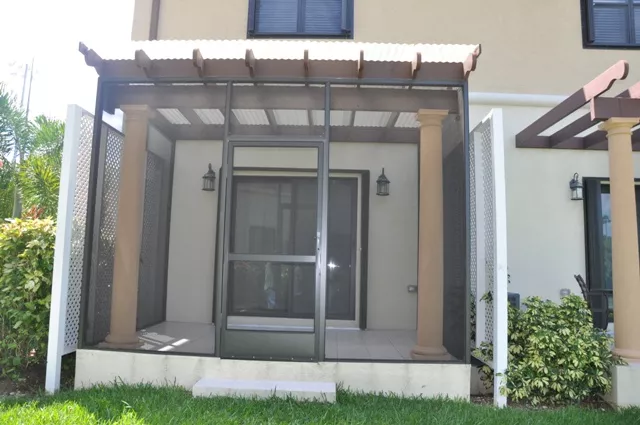 PATIO ENCLOSURE WITH CORRUGATED ROOF