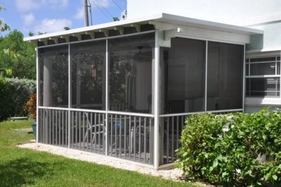 PATIO ENCLOSURE WITH INSULATED ROOF & PICKET SYSTEM